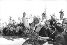 Pope Paul VI waving.