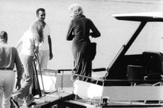 Georges Jean Raymond Pompidou getting on a yacht.
