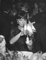 Annabel Buffet looking and holding at the flag in the event, 1962.
