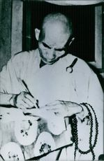 A man writing something with the pen.