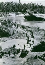 Aerial view of soldiers marching in street.