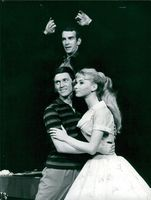 "Britta Pettersson and Walter Norman in ""Fantasticks"". Over them Christian Bratt as the narrator El Gallo"