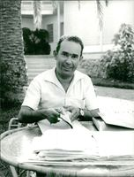 Mehdi Ben Barka looking at camera and smiling.
