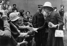 Georges Jean Raymond Pompidou`s wife shaking hands with kids.