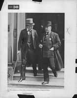 Winston Churchill walking with a man.