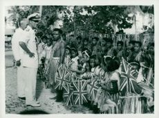 Prince Philip and District Commissioner Percy Roberts speak with school children