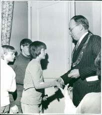 Young Canadian football players receives a diploma
