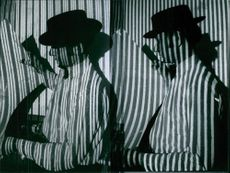 Two men in a striped clothing.