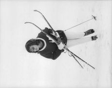 Princess Soraya walking holding skis.