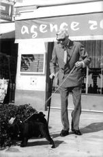 Duke of Windsor walking his dog out.