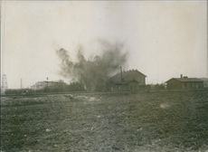 Bomb blasts near the houses during first world war.