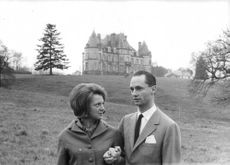 Princess Irene of Netherlands looking at her husband  Duke Carlos Hugo with the castle on the background. 1964.