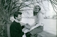 A photo of Yvette Mimieux being happy with Serge Bourguignon.