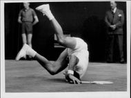 Bob Hewitt makes a backing during the match against Bobby Wilson in Wimbledon in 1962