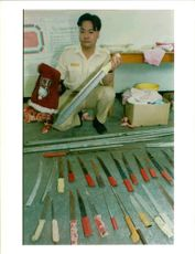 Correctional service officer wat kai-ning displays of homemade weapons found at the whitehead detention center for Vietnamese.