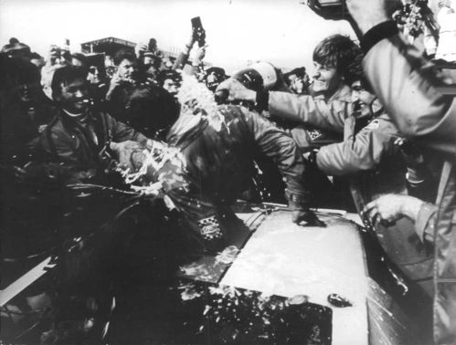 Soldiers celebrating and drinking wine on the road.