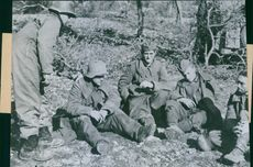 Sad and dejected German soldiers captured in Italy during World War II, they sitting with despondency