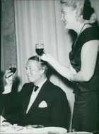 Maurice Chevalier enjoy drink.