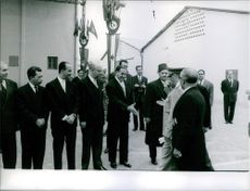Ferhat Abbas shaking hands with President Tito in Tunisia.