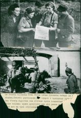 The first pictures from Vilna since the Russians penetrated the city. Top: Partisans read a day order. Below: Russian artillery burns on a farm - 16 July 1944