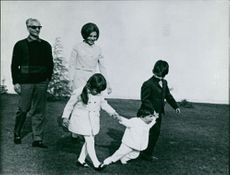 Mohammad Reza Shah Pahlavi with his family bonding together.