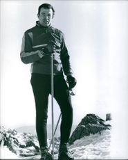 Alfonso Duke of Anjou on top of a mountain skiing.