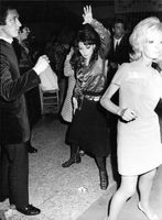 Pascale Petit and man dancing in a party.