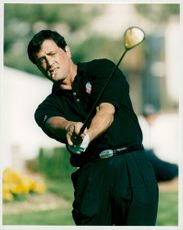 Sylvester Stallone plays golf