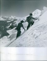 A photo of climbers on their way to the mountain range of Himalayas. 1963