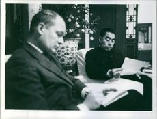 Premier of the People's Republic of China Zhou Enlai is reading something, 1957.