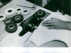 Paco Rabanne making patterns for a fashion design.