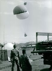 Military supplies dropped by a parachute in a military camp in Vietnam.  - 1965