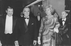 Georges Jean Raymond Pompidou along with his wife arriving at a function.