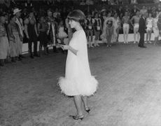 Claudia Cardinale standing.