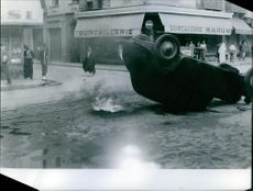 Destroyed vehicle in street.