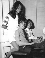 Leslie Caron with her children playing piano.