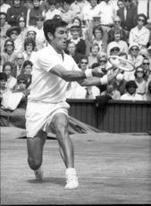 Ken Rosewall was in action during the match against Tony Roche in Wimbledon in 1970