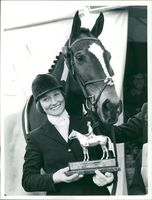 Lucinda Green holds Badminton trophy with her horse 'Regal Realm'