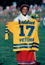 Crown Princess Victoria receives his own hockey shirt from the national hockey team on his 17th birthday