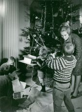 Christmas celebration being done by Queen Paola of Belgium and children.