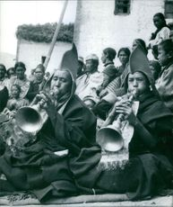 Two playing musical instrument during traditional culture.