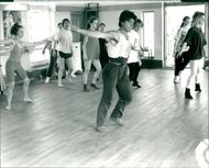 Richard Mansfield leads the contemporary dance.
