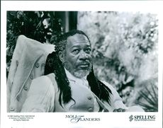 Morgan Freeman, a branded thief, has risen to power as Mrs. Allworthy's aide in Moll Flanders.