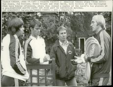 Tennis player Stan Smith talks with Jim Dellany, Bruce Wright and Pat Dupre.