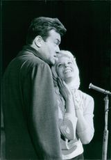 Georges Ulmer and daughter Laura Ulmer at the microphone.