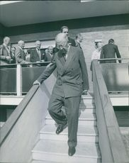 King Gustaf V of Sweden walking down the stairs.