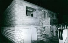 A view of a house at night.