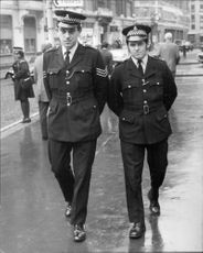 Two policemen on patrol outside Scotland Yard.