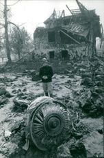 A man standing in ruins.  Taken - Circa 1963