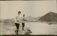 General standing beside the river and fishing.